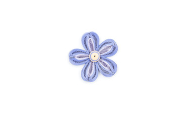flower made by quilling on a light background