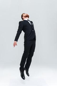 Full length business man flying