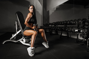 Bodybuilding woman on fitness club