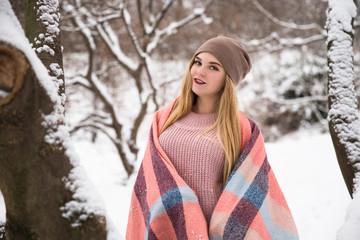 Young happy teenage girl enjoy snow in winter city park outdoor