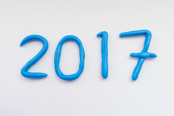 Numbers for 2017 New Year made from blue plasticine.