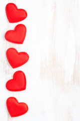 vintage white wooden background with red hearts, vertical