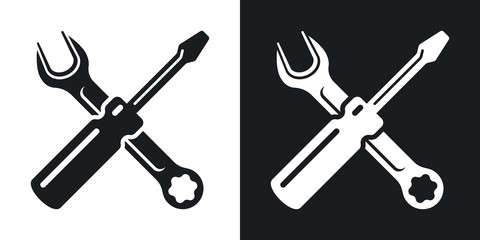 Simple two-color vector icon of a screwdriver and a wrench on a black and white background. Hand tools for repair and construction
