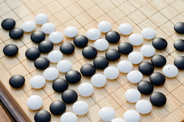 Chinese board game go  with black and white stones