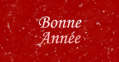 "Happy New Year text in French ""Bonne annee"" on red background"