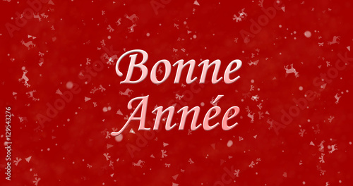 happy new year text in french bonne annee on red background