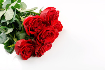red roses bouquet on white background with copy space