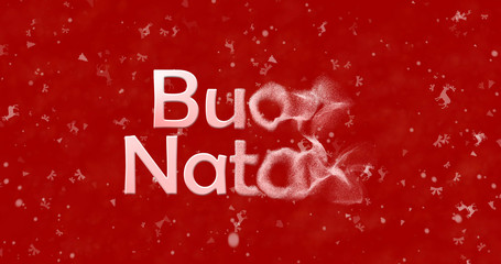 "Merry Christmas text in Italian ""Buon Natale"" turns to dust from right on red background"