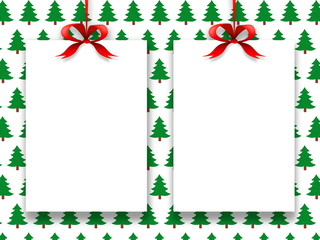 Two blank frames hanged by red Christmas ribbons against green trees pattern background