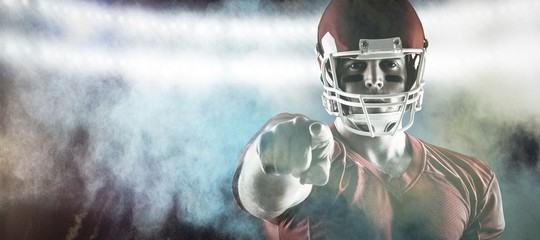Composite image of american football player pointing at camera