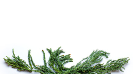Christmas border frame made of fir tree branch. Flat lay. Concept New Year`s background for congratulations card, market winter sale banner or poster with copyspace for text. Isolated on white.