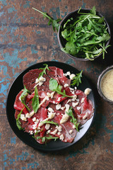 Beef carpaccio with arugula and sauce