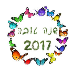 Round Frame Pattern Designed of colorful flying butterflies.Number 2017 and Hebrew greeting words Shana Tova - Happy New Year English equivalent. Designed of christmas tree. Isolated on white.