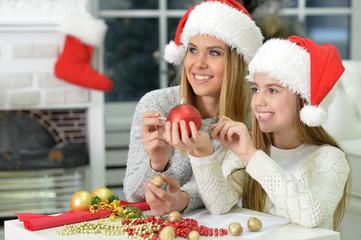 Sisters preparing for Christmas