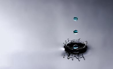 Water splash and three water drops
