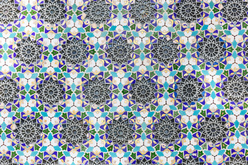 Background of blue mosaic with wrought iron elements