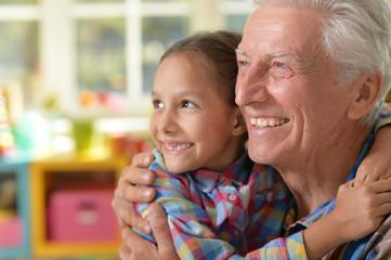 Grandfather and granddaughter hug