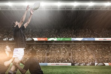 Composite image of rugby fans in arena