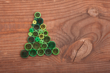 Firtrees made with quilling technique on a wooden surface