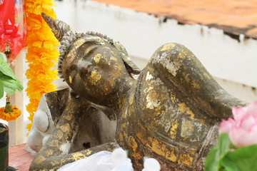 lying, sleeping ancient buddha statue filled with gold leaf, one of the most important and visiting historical landmark at ayutthaya, Thailand for tourism