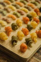 Colorful pasta with nice shapes lined