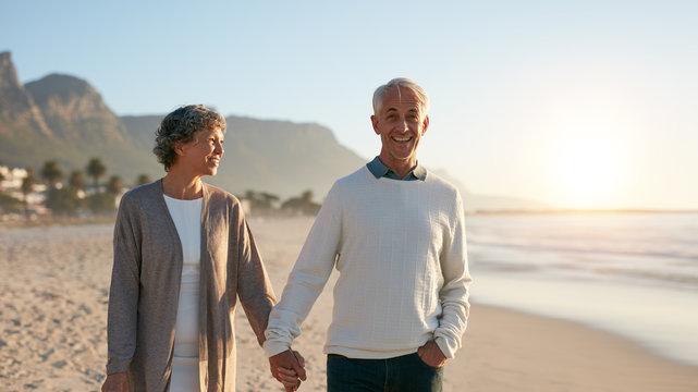 Senior couple enjoying a stroll on the beach