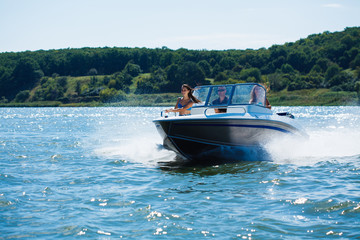 Girls ride on the boat to drift