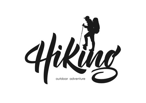 Vector illustration: Modern brush lettering of Hiking with silhouette of climber.