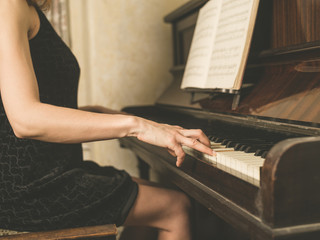 Woman in dress playing the piano