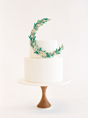 Two tier wedding cake with floral garland