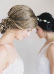 Two women wearing bridal wear