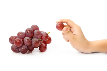 little hand picked a grape from bunch of  red grapes isolated on Fototapete