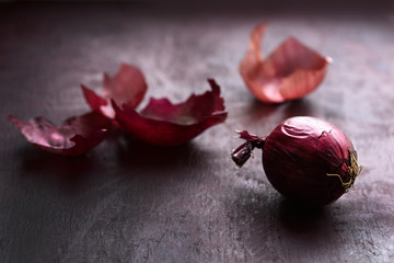 Red onion on table, still life