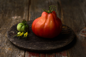 Heirloom tomatoes on wooden board, still life