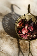 Dried hibiscus flowers in basket, still life