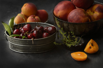Bowl of cherries, peaches and apricots, still life