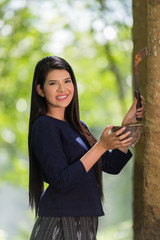 woman tapping in rubber tree row agricultural