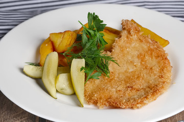 Chicken entrecote with potato and salty cucumber