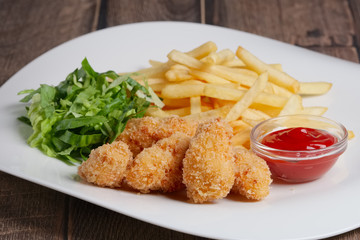 chicken in breading with french fries and green salad
