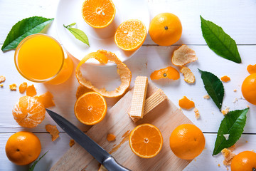 Orange juice on white wooden table. Top view