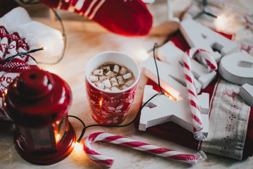 Christmas still life with XMAS letters, cup of cocoa with marshmallows and cinnamon