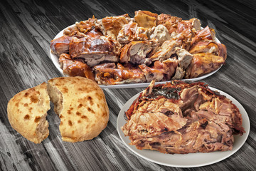 Plateful Of Spit Roasted Pork Slices And Juicy Piglet Ham With Pitta Bread Loaf Isolated On Old Cracked Flaky Wooden Garden Table