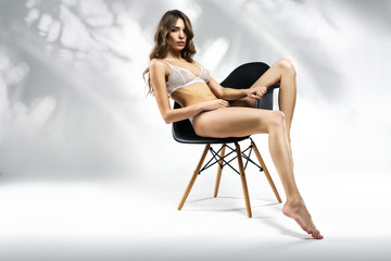 Beautiful Fashion Woman Posing In White Lingerie