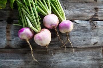 rustic organic turnips on genuine wood background for vegetarian food