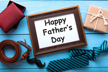 Happy Father's Day set of things on wooden table background. Topview