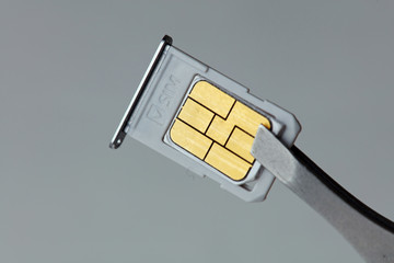 Close up on nano sim card. Cellular and mobile technologies