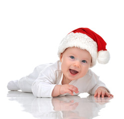 Infant child baby girl lying in red christmas santa hat happy sm