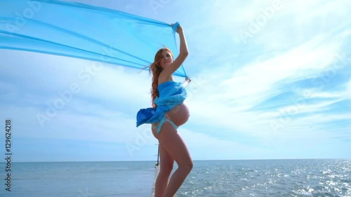 Pregnancy concept  Pregnant woman enjoy summer vacation
