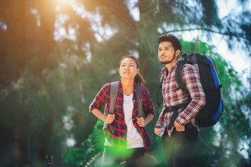 Young couple go adventure hiking together on vacation.
