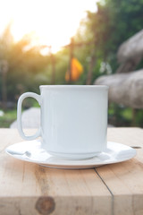 Coffee cup on table  with sunlight. Beauty nature background